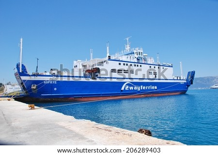 CORFU, GREECE - JUNE 23, 2014: 2Way Ferries ship Dorieus moored at Kerkira harbour on the Greek island of Corfu. The 95mtr ship was built in 1989 in Sunderland, England. - stock photo