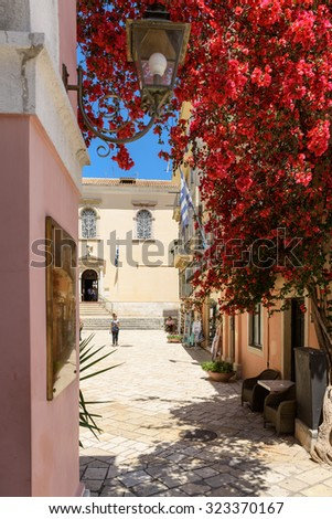 CORFU TOWN, GREECE - MAY 20: entrance to The Saint Spyridon Church with flowers blooming on the foreground on May 20, 2015. - stock photo