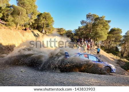 CORINTHIA, GREECE - JUN 1: Ukrainian driver Yukhym Vazheievskyi and his codriver Oleksandr Gorbik in a Subaru Impreza WRX race in the 59th Acropolis Rally of Greece, on Jun 1, 2013 in Loutraki, Greece - stock photo
