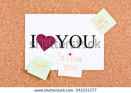 Cork board and a sheet with the words I love you, sorry, call me  - stock photo