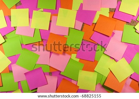 Cork board with colored sticky note - stock photo
