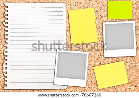 Cork board with empty white page and notes - stock photo