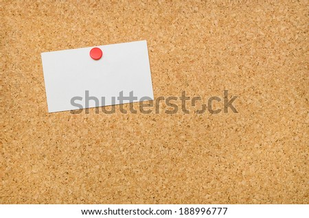 Cork Board with Thumb Tacked Blank Note Card for your Copy - stock photo