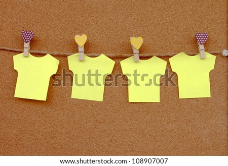 Cork board with yellow notes. - stock photo