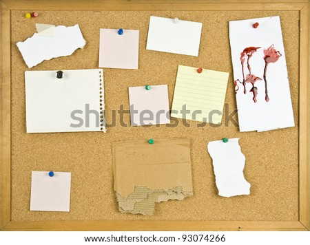 Cork bulletin board with blank notes and blood stain. - stock photo