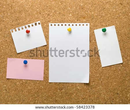 Cork bulletin board with notes. - stock photo