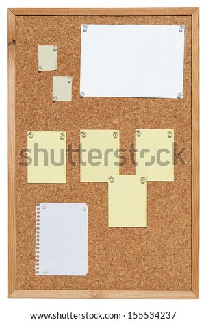 Cork bulletin board with notes on slips of paper. - stock photo