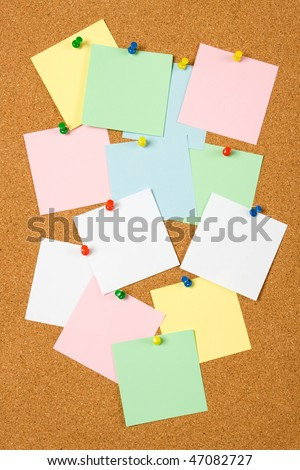 Cork notice board with blank paper notes - stock photo
