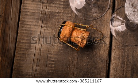 Cork of a champagne bottle against two champagne flutes - stock photo