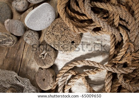 Cork, rope and stones - stock photo
