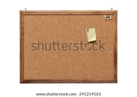 corkboard with a single empty yellow post-it note. There are colorful pushpins on the upper right of the board. - stock photo