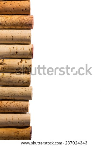 Corks stacked vertically on left side with white background. - stock photo