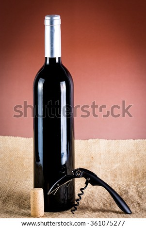 corkscrew and Cork and bottle of wine - stock photo