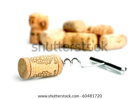 Corkscrew and wine corks - stock photo