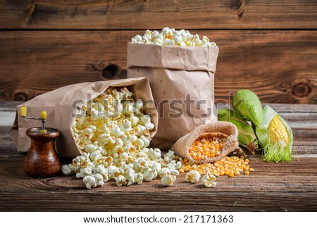 Corn and popcorn in rustic version - stock photo