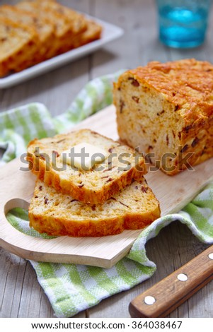 Corn bread loaf with bacon and cheddar cheese - stock photo