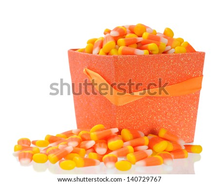 corn candy falling out busked isolated on white - stock photo