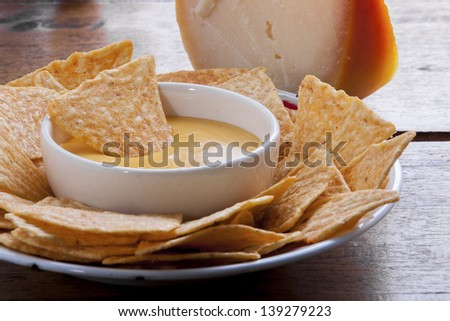 corn chips and cheese sauce - stock photo