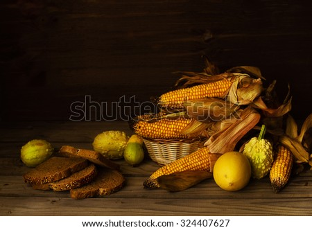 Corn cob with zucchini and bread on the table - stock photo