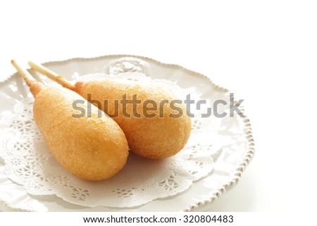 Corn dog on dish for kid food image - stock photo