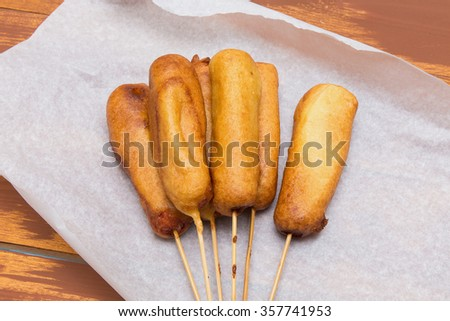 Corn dog to do at home. A popular snack in the American fast fude. - stock photo