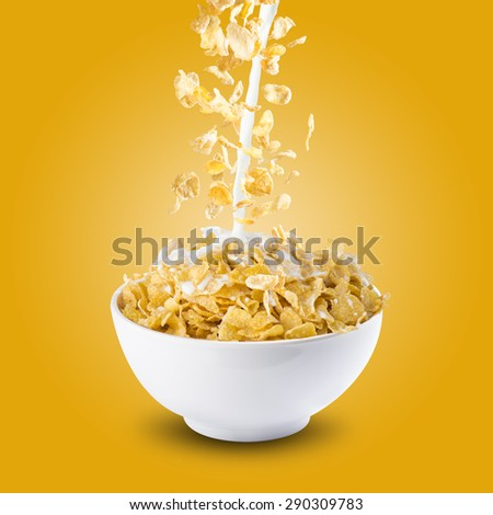Corn Flakes and Milk Splash on Bowl of Cereal - stock photo