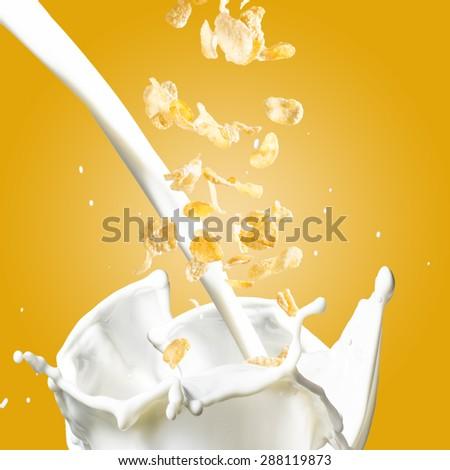 Corn Flakes Falling into Milk Splash - stock photo