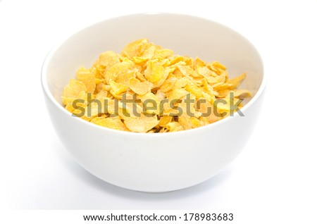 Corn flakes in bowl isolated - stock photo