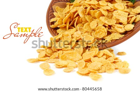 Corn flakes in dish isolated on white - stock photo