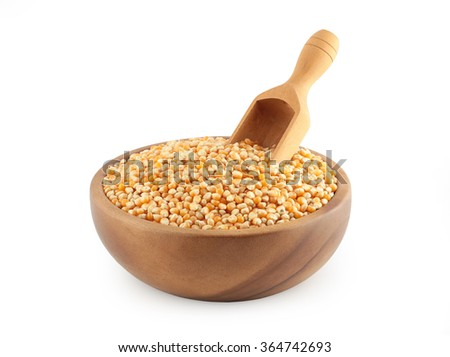 corn grain in wooden bowl with a scoop - stock photo
