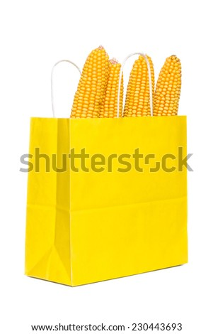 Corn In Yellow Paper Shopping Bag On White Background - stock photo