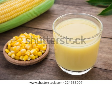 Corn milk in glass, kernel corn on plate and fresh corn  - stock photo