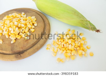 corn on the cob, husk organic food nature background - stock photo