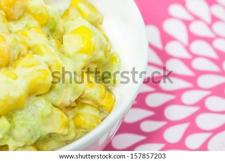 Corn salad with avocado. - stock photo
