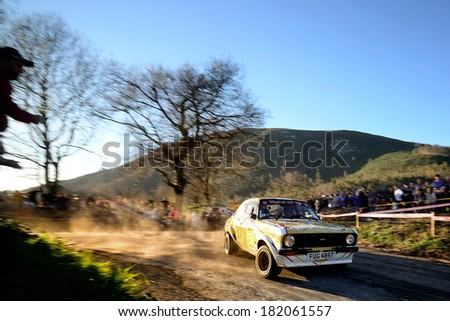 CORNELLANA, SAPIN - MAR 8: Belgian driver Yannick Bodson and his codriver Hugues Lecomte in a Ford Escort RS2000 Mk II race in the 6th Solo Escort, on Mar 8, 2014 in Asturias, Spain. - stock photo