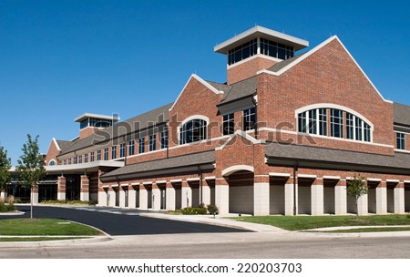 Corner Angle of Red Brick Building - stock photo