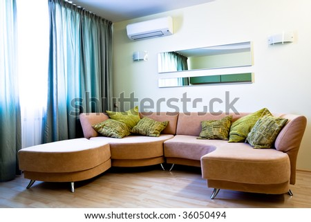 Corner in modern studio interior with sofa - stock photo