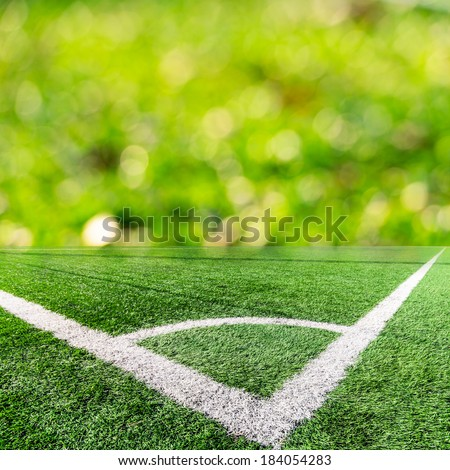 Corner of a soccer field and green bokeh - stock photo