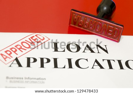 corner of the stamp printed on complete loan applications was approved - stock photo