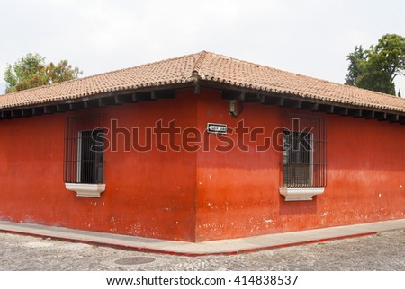 Corner perspective colonial house with barred windows in Antigua, Guatemala. - stock photo