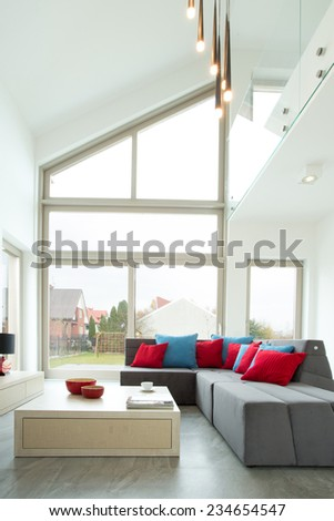 Corner sofa and color cushions in contemporary living room - stock photo