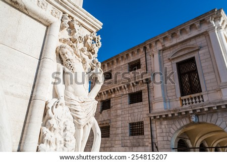 Corner statue of the historical Doge's Palace near by the venetian prison on sunny clear blue sky, Venice, Italy - stock photo