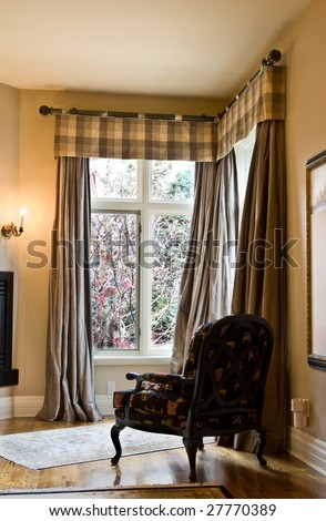 Corner window coverings using a wrought iron rod and puddled side panels - stock photo