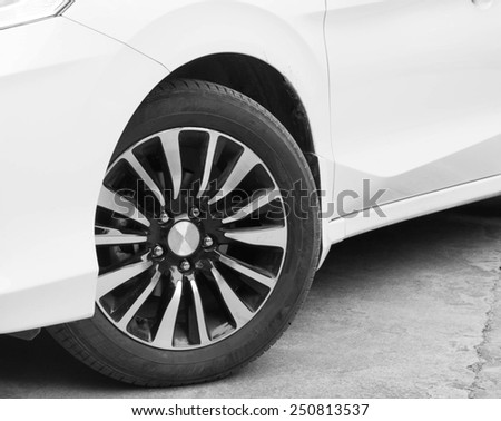 Cornering automobile tires - stock photo