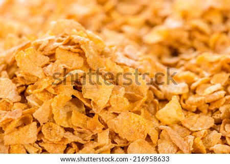 Cornflakes (close-up shot) for use as background image or as texture - stock photo