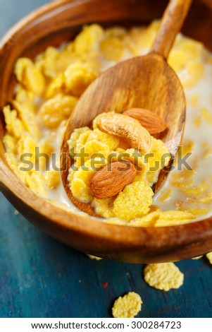 Cornflakes with nuts close up. Selective focus - stock photo