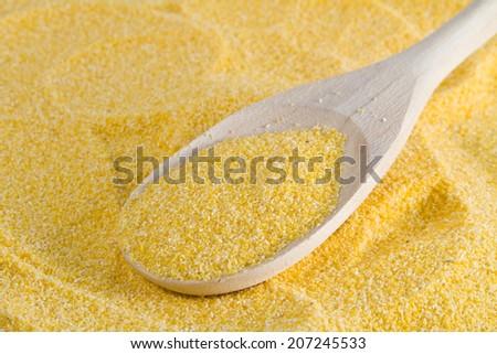 cornmeal flour on a wooden spoon - stock photo