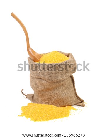Cornmeal in bag with spoon. Isolated on a white background. - stock photo