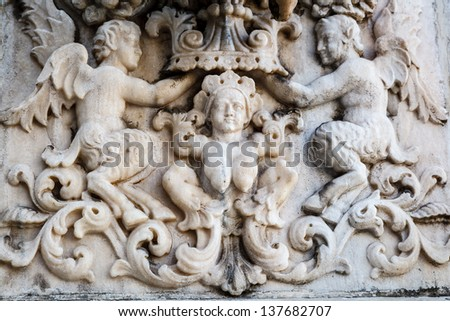 Coronation of the Virgin Bas-Relief on the Roof of Milan Cathedral, Italy - stock photo