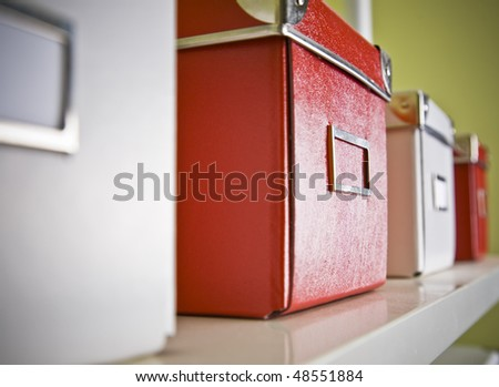 corporate archive boxes on shelf - stock photo